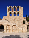 The odeon of herodes atticus in athens greece ruins stand before a brilliant blue greek sky Stock Images