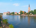 The oder embankment leisure walk along river with a view on spires of wroclaw cathedral on tumski island poland Stock Images