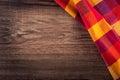 Odgórny widok w kratkę pielucha na drewnianym stole Zdjęcie Royalty Free
