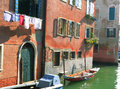 Off off canalasso canareggio venezia grand canale sun lit rugged facade of an old house along a canal in Stock Image