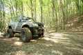 Off-road big-wheeled monster truck in mud forest Stock Photography