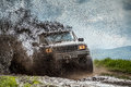 Off road car sprays mud Stock Images