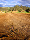 Off road driving tracks muddy left by a car doing in australia Stock Photography
