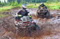 Off road racing on atv competition mud Stock Photography
