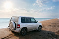 Off-road vehicle on the beach Royalty Free Stock Photo