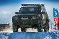 Off-road vehicle brand Nissan overcomes the track Royalty Free Stock Photo