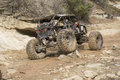 Off road vehicle in creek bed rock climbing making it s way through the hunter s canyon colorado the just thawing and running Stock Images