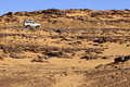 Off-road vehicle on a rough desert road Royalty Free Stock Images