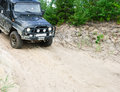 Off road vehicle slides down a sandy slope x with place for text in summer Stock Photo