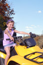 Off roading on a four wheeler girl riding in the country Stock Images