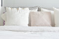 Off white pillows setting on bed with english country style bedding Royalty Free Stock Photo