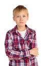 Offended boy seriously young in checkered shirt with his arms crosed isolated Royalty Free Stock Photos