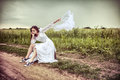 The offended bride throwing out a wedding veil Royalty Free Stock Photo