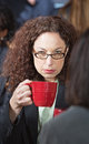 Offended business woman businesswoman with friend holding coffee cup Royalty Free Stock Images