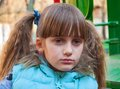 Offended child portrait of girl with big gray eyes and pigtails Stock Image