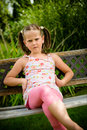 Offended child portrait of small outoor in backyard Royalty Free Stock Image