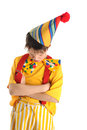 Offended clown boy sulking dressed in carnival costume Royalty Free Stock Images