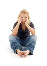 Offended girl sitting on the floor picture of Royalty Free Stock Images
