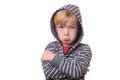 Offended portrait of a young boy on white background Stock Image