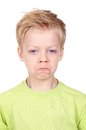 Offense cute little boy looking at camera with offended expression Royalty Free Stock Images