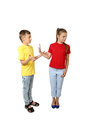 Offer and rejection gesture - teenage boy and girl stand in full
