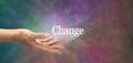 Offering change female hand outstretched with the word appearing to move outwards indicating is suggested on a multicolored stone Royalty Free Stock Photos