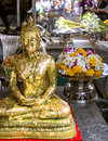 Offering for Gold Buddha in Wat Phra Kaew, Emerald Buddha Temple Royalty Free Stock Photo
