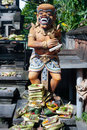 Offerings are made to a traditional balinese statue, Bali, Indon Royalty Free Stock Image