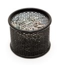 Office accessories paper clips in the black metal pot on a white background Stock Photography