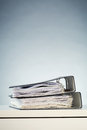 Office binders with documents two paperwork stacked over a white desk surface Stock Photo