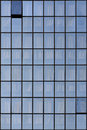 Office blue windows grid of with curtains Stock Image