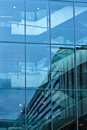 Office building blue reflections in the windows of the Royalty Free Stock Images