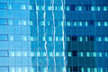 Office building reflected in glass facade of another office building Royalty Free Stock Photo