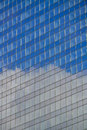 Office building with reflection of clouds modern and blue sky Royalty Free Stock Photography