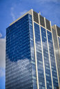 Office building with reflection of clouds modern and blue sky Royalty Free Stock Photos