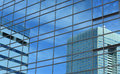 Office building reflections buildings reflected in glass windows Royalty Free Stock Photo