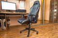 Office chair at the computer desk Royalty Free Stock Photo