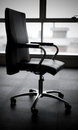 Office chair an empity luxury in a dark Royalty Free Stock Images
