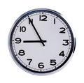 Office clock shows five to nine