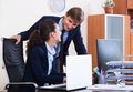 Office colleagues successfully working together happy adult indoors Royalty Free Stock Images