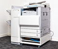 Office copying machine big grey multi task copy in corner Royalty Free Stock Image