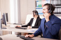 Office of customer support line with people working in it Royalty Free Stock Photo