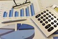 Office desk with charts , histograms and financial documents