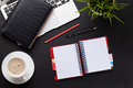 Office desk with laptop, coffee, notepad Royalty Free Stock Photo