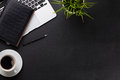 Office desk with laptop, coffee, notepad and plant Royalty Free Stock Photo