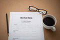 Office desk with resume information, Coffee cup, black pencil an Royalty Free Stock Photo