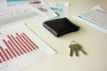 Office desk with wallet and keys Royalty Free Stock Photo