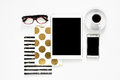 Office desk on white background touch pad tablet gadget cellphone with gold stylish books, top view Royalty Free Stock Photo
