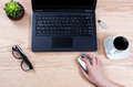Office desktop setup with female hand holding wireless computer Royalty Free Stock Photo