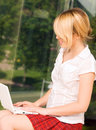 Office girl with laptop computer Royalty Free Stock Photo